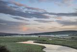 Beautiful dawn landscape over English countryside with river slowly flowing through fields - 176691262