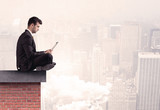 Office worker sitting on rooftop in city - 176691817
