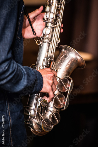 Saxophone in the hands of a musician Poster