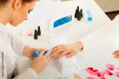 Aluminium Manicure Woman getting manicure done file nails