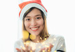 Quadro smiling asia woman wear santa hat holding party string lights with bokeh light at Christmas party,Holiday celebration concept,sparkling light decoration,make a wish.