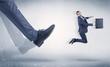 Quadro Businessman foot kicking small businessman