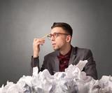 Businessman behind crumpled paper - 176701895