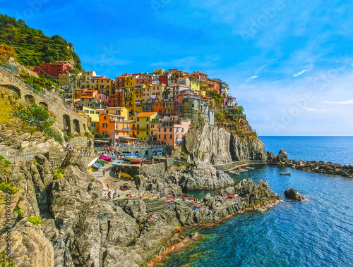 Poster Liguria Colorful traditional houses on a rock over Mediterranean sea, Manarola, Cinque Terre, Italy