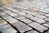 wet old granite pavement closeup - 176706833