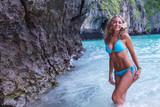 Woman walking on beach - 176709603