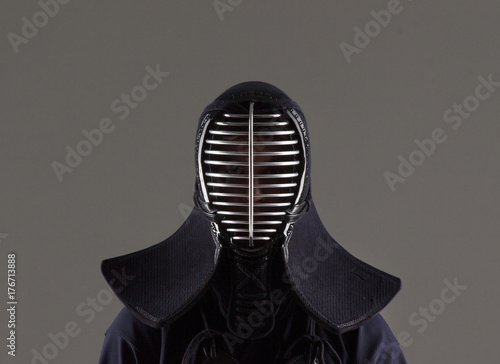 male in tradition kendo armor wearing helmet.  © luckyguy123