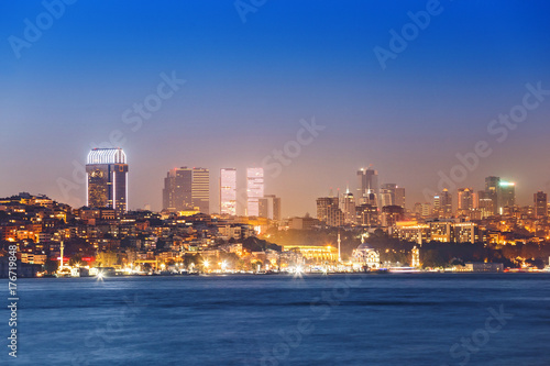 night view of illuminated towers and skyscappers in istanbul, taken from seaside Poster