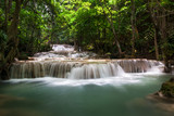 Waterfall with deep forrest waterfall in Erawan waterfall National Park Kanjanaburi Thailand.