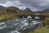 The old bridge at Sligachan on the Isle of Skye in the Cuillin Hills in the Inner Hebrides of northwest Scotland. poster