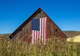 Weathered Red Barn with American Flag - 176729648