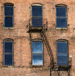 Red Brick Building with Windows and Fire Escape
