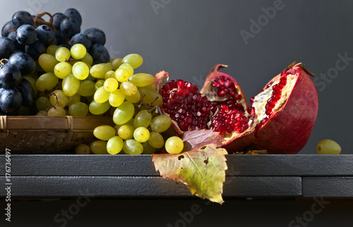 Blue and white grapes with pomegranate