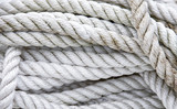 close up of tangled and twisted grungy white nautical rope - 176744003