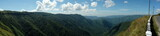 Panoramic view of mountain valleys and road
