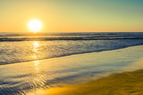 Bright colors on vacation. Sunset bright sun sets over the horizon. Beautiful beaches of California. South of the USA