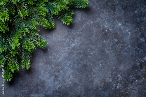 Christmas fir tree over stone - 176748275