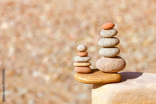 Rock zen pyramid of white, red and yellow stones. Concept of balance, harmony and meditation