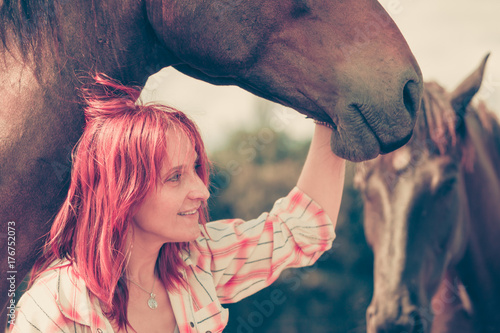 Western animal lover woman hugging horse Poster