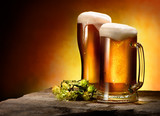 Two glasses of beer and hops - 176752636