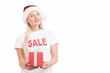 Beautiful cheerful fashion christmas girl in Santa's hat with gift box over white