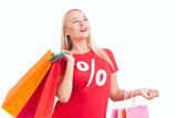 happy young woman  carrying shopping bags - 176772487