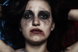 sad woman with smeared make up in dark - 176786259