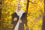happy woman smiling in park at autumn sunset, toned image - 176786663