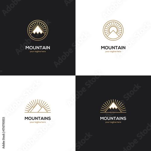 Four mountain logo in golden color.
