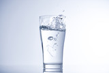 ice cube falling into glass of water - 176794621