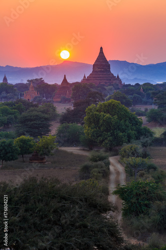 View from afar of the ancient pagodas (stupas) visible among rugged fields and t Poster
