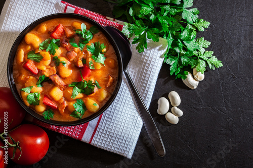 Naklejka White bean soup with potatoes, tomatoes, paprika, and bacon