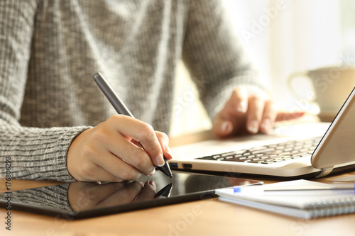 Designer working drawing with a digital pen Poster