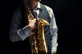 Young man playing the Saxophone - 176811480