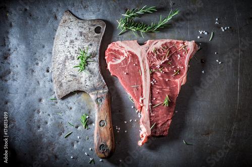 Foto op Plexiglas Steakhouse Tasty red steak with salt and rosemary
