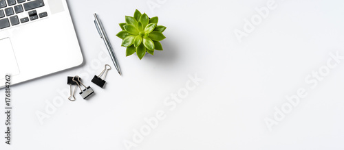 Overhead shot of office accessories on white background