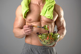 Healthy man eating a salad - 176821874