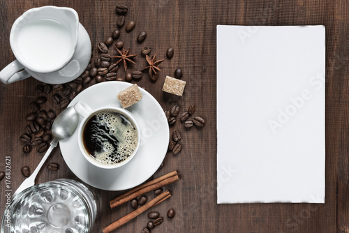 Wall mural Cup of coffee on the wooden table