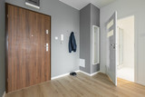 Entryway with wooden door - 176833681