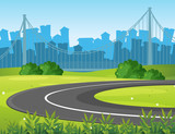 Road and park with city buildings in background - 176835028