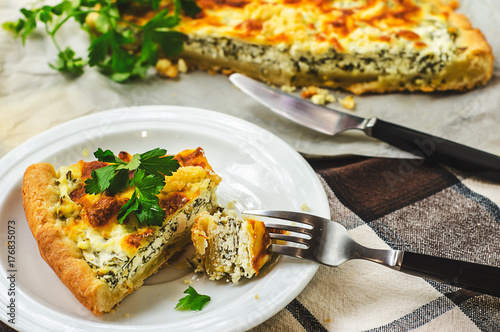 Sliced pie with spinach and cheese. Healthy homemade food photo concept - 176835073