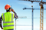 Engineers are working at building sites. - 176842633