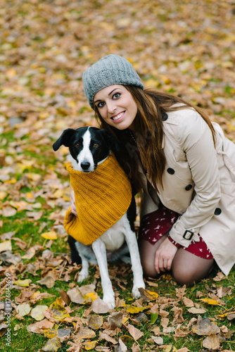 Woman and dog portrait in autumn at the park.