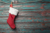 Christmas sock over rustic wooden background - 176845866