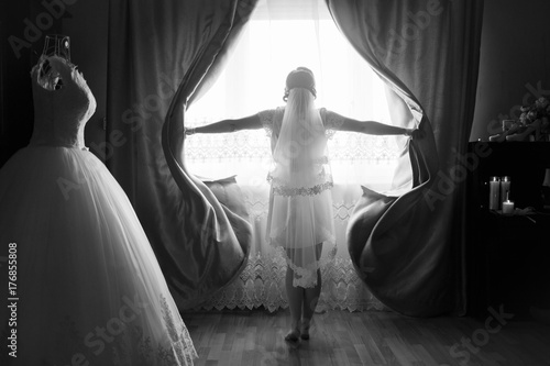 Plakát bride standing at the window and waiting for a loved one