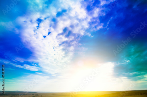 Sky. Blue sky background with purple and green clouds. Sky with clouds on sunset