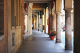 Montagnana, Italy - August 6, 2017: columns and arches of pedestrian areas on the streets of the city. - 176861276