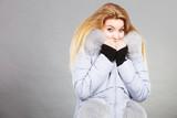Woman wearing winter warm furry jacket - 176864435