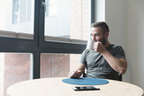 Man drinking coffee in the morning - 176867631
