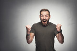 Excited man on grunge background - 176868030